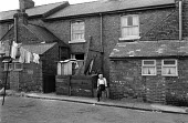 Elderly man sitting outside terraced housing, 1976 Doncaster, South Yorkshire - NLA - 26-10-1976