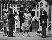 Royal Ascot Races, Berkshire 1970. Men in morning dress doff their top hats to a lady - NLA - 19-06-1970