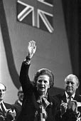 Margaret Thatcher waving to applause, 1982 Conservative Party Conference, Brighton, Lord Thorneycroft (R) - NLA - 08-10-1982
