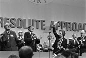 Margaret Thatcher waving to applause, 1982 Conservative Party Conference, Brighton, Willie Whitelaw, Cecil Parkinson and Dennis Thatcher - NLA - 08-10-1982