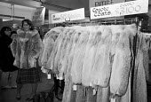 Harrods sale, London 1983. Coyote fur coats for sale - Peter Arkell - 07-01-1983