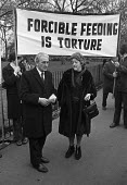 Parents of the Price sisters protest at force feeding 1974 of the sisters in Brixton prison. Imprisoned for car bombing The Old Bailey in 1973. Forcible Feeding is Torture - Peter Arkell - 10-03-1974