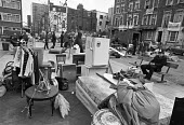 Eviction of squatters, Tolmers Square, Camden, 1979, London. Belongings and household items in the street guarded by a policeman. The squatters demanded to be rehoused rather than evicted. The square... - Peter Arkell - 04-05-1979
