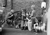 Family evicted from their council house, 1975, Riverside Gardens, Hammersmith, West London, children in a huddle consoling each other. - Peter Arkell - 25-09-1975