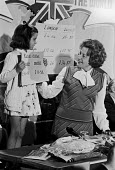 Barbara Castle, Campaign to leave the EEC and Common Market, referendum campaign, London 1975 getting the help of a child to indicate rising prices in the EEC - Peter Arkell - 29-05-1975