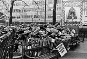 Winter of Discontent 1979. Rubbish piling up, Leicester Square, Central London, an official collection centre, during the refuse collectors strike. Jaws 2 film cinema billboard - Peter Arkell - 13-02-1979