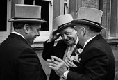 Royal Ascot races 1972. Men in top hats and morning dress and cigars talking - Peter Arkell - 20-05-1972