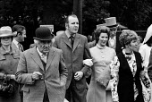 Royal Ascot races 1972. men in top hats, morning dress with cigar and women in hats arriving at Ascot racecourse, Berkshire - Peter Arkell - 20-06-1972