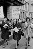 London 1973, women workers from Huntley and Palmer protest against closure of their biscuit factory in Reading . Capitalism's Ugly Face Scowls Again! Save Our Jobs. Reading was known as Biscuit Town - Peter Arkell - 22-05-1973
