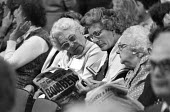 Conservative Party Conference, 1984 Brighton, delegates reading about the IRA bombing of the Grand Hotel in the newspapers the morning after - Peter Arkell - 12-10-1984
