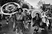 Notting Hill Carnival London 1982 women dressed as Geishas on the parade - Peter Arkell - 29-08-1982