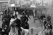 Police protecting small National Front march, 1978, East End of London from a counter protest of anti fascists - Ray Rising - 24-09-1978