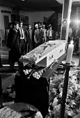 Blair Peach funeral Southall 1979. Mourners vigil, the body of Blair Peach in his coffin the day before his funeral. Dominion cinema, Southall, West London 1979. Peach was killed by SPG police at an a... - Ray Rising - 12-06-1979