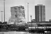 Demolition of 15 year old tower block, 1981, Stratford Point, Henniker Road, Newham, East London. The flats were damp and unsafe - Ray Rising - 22-11-1981