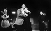 The Fire Raisers by Max Frisch Royal Court Theatre, London 1961. Directed and produced by Lindsay Anderson, Alfred Marks and Dora Hare centre stage - Romano Cagnoni - 20-12-1961
