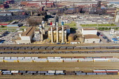Dearborn, Michigan, USA. CSX rail yard by the Ford River Rouge industrial complex. Red, white, and blue chimneys of the Dearborn Industrial electrical generation plant - Jim West - 12-08-2020
