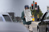 Homeless youth begging from cars waiting at traffic lights, Duddeston, Birmingham - John Harris - 15-08-2020