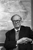 Sir William Penney, nuclear physicist, 1985. Australian High Commission, London, Press conference. nuclear physicist who led development of the British atomic bomb, with a map of Australia where the b... - Ray Rising - 11-01-1985