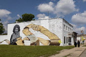 "Michigan, USA. Mural entitled ""Way Too Many"" by Sydney James depicting Malice Green who was beaten to death by two Detroit policemen in 1992. The scroll lists the names of many other victims of police... - Jim West - 09-08-2020"