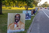 Detroit, USA: Memorial to Covid-19 Victims. 900 portraits of those lost to Coronavirus in a public memorial. Faces on billboards of Detroit residents who died lining the roads of Belle Isle State Park... - Jim West - 29-08-2020