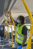 Detroit, USA, worker sanitizing a city bus between journeys to protect against the coronavirus. - Jim West - 09-06-2020