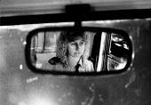 London 1989. In the rear view mirror, Ambulance worker June Tuck driving to a road accident with several casualties in Holborn, central London. - Melanie Friend - 18-10-1989