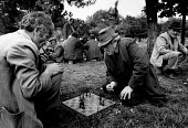 Elderly men playing chess in a park, Tirana, Albania 1990 - Melanie Friend - 12-04-1990