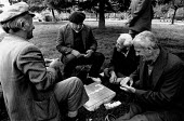 Elderly men playing dominoes a park, Tirana, Albania 1990 - Melanie Friend - 12-04-1990