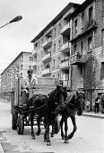 Horse and cart driving down the street, Berat, Albania 1990 - Melanie Friend - 18-04-1990