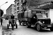 Lorry passing a horse and cart, Berat, Albania, 1990 - Melanie Friend - 18-04-1990