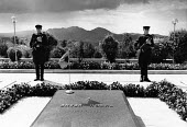 Soldiers guarding Tomb of Enver Hoxha, Tirana, Albania, 1990. Two army soldiers with AK47s in the The People's Cemetery standing honour guard over the grave of the former Albanian Communist who died i... - Melanie Friend - 19-04-1990