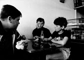 Teenagers drinking Coca Cola, cafe, Berat, Albania 1996 smoking cigarettes - Melanie Friend - 03-05-1996