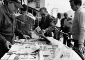 Men buying newspapers, Sunday morning, Tirana, Albania 1996 - Melanie Friend - 05-05-1996