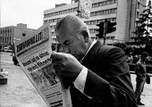 Men buying newspapers, Sunday morning, Tirana, Albania 1996. Man reading the Socialist Party newspaper Voice of The People - Melanie Friend - 05-05-1996