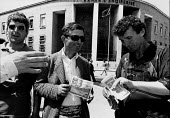 Money changers outside Albanian National Bank, Tirana, 1996 Albania. Dealers exchanging currancy on the black market in the street. Albania was convulsed by the dramatic rise and collapse of several h... - Melanie Friend - 07-05-1996