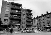 Poor housing block, Shkodra, Albania 1996. Cyclists - Melanie Friend - 08-05-1996