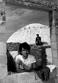 Worker building a cafe round a bunker, Durres, Albania 1996. Workers take a break, Durres, Albania, The program of Bunkerization resulted in the construction of 173,371 concrete bunkers around the cou... - Melanie Friend - 10-05-1996