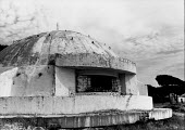 One of the many concrete bunkers, Durres, Albania, 1990. The program of Bunkerization resulted in the construction of 173,371 concrete bunkers around the country. The bunkers were intended to establis... - Melanie Friend - 10-05-1996