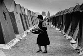 Albanian refugees Restinco Refugee Camp Brindisi Italy 1991. The camp was established by Italian Red Cross in an ex military barracks to house refugees from Albania fleeing the collapse of communism i... - Melanie Friend - 14-03-1991