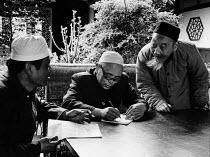Chengdu, China, 1986. Muslim men in discussion, mosque garden, Sichuan Province - Melanie Friend - 24-03-1986