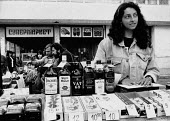 Young woman selling western cigarettes, whisky, Kazanlak, 1992, Bulgaria, from a street market stall - Melanie Friend - 10-06-1992