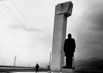 Shepherd and statue of Dimitar Blagoev, 1992, near Kazanlak, Bulgaria. Blagoev was the founder of Bulgarian socialism - Melanie Friend - 10-06-1992