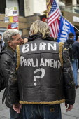 Burn Parliament on a leather jacket, March For Freedom against Covid restrictions, London - Jess Hurd - 18-10-2020