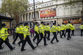 Police marching past City of Angels billing, Garrick Theatre, London - Jess Hurd - 18-10-2020