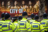 Police unit filing past City of Angels billing, Garrick Theatre, Central London. - Jess Hurd - 18-10-2020