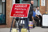 Covid-19 Maintain Social Distance sign, pub customers sitting outside, Stratford Upon Avon, Warwickshire - John Harris - 07-10-2020