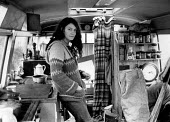 RAF Molesworth Peace Camp 1984 Peace protester Lynn inside the bus which is now home for herself and her children, Green Village, Northamptonshire - Melanie Friend - 11-11-1984