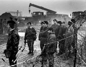 RAF Molesworth Peace Camp 1985 Soldiers, barbed wire and vehicles. Northamptonshire. 1500 police and troops were deployed to the site to secure the seven-mile base perimeter for the MOD - Melanie Friend - 06-02-1985