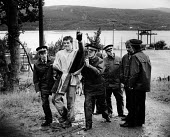 Faslane Naval Base Clyde 1985. Police arresting protester for scaling the perimeter fence of the Trident nuclear base, The Clyde, near Glasgow, Scotland. Anti nuclear weapons Stop Trident protest. Pro... - Melanie Friend - 16-09-1985