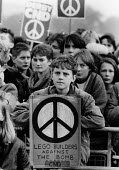 Child protester, Lego Builders Against the Bomb placard, CND Rally, Hyde Park, London 1985. Anti nuclear weapons protest Anti nuclear weapons protest - Melanie Friend - 26-10-1985